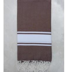 Brown striped white throw