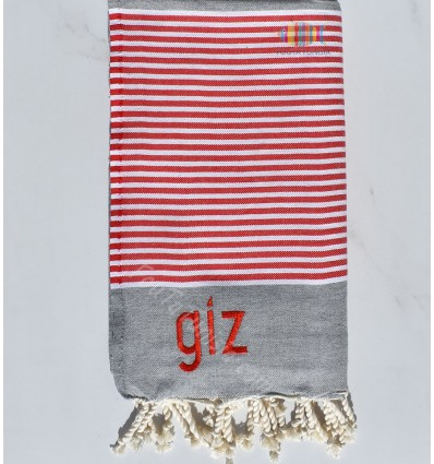 gray beach towel with white and red stripes GIZ embroidery