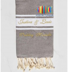 taupe color beach towel embroidered with golden lurex thread for a wedding